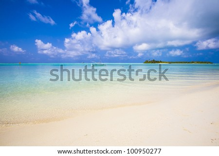view to a tropical island from the beach