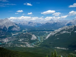 view to a valley in the mountains in canada