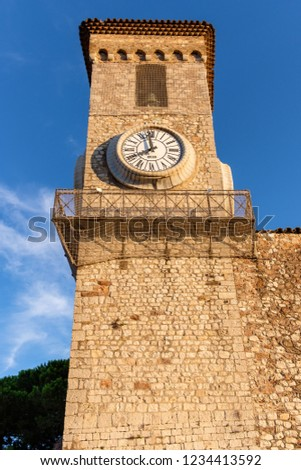 View to an old bell tower in the city of Cannes. Close up photo. Shot at dawn. No clouds. History of France