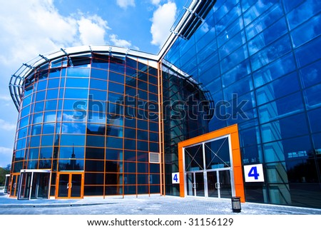 view to enter to modern trade center with orange door - stock photo
