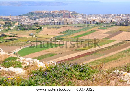 View to Mgarr bay and Maltese coast from a hill top in Gozo island