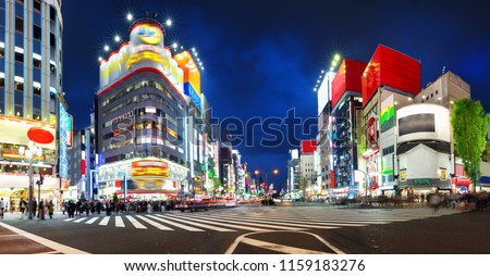 View to night Tokyo in Shinjuku district with lots of neon lights
