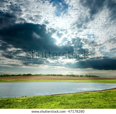 view to overcast landscape with pond