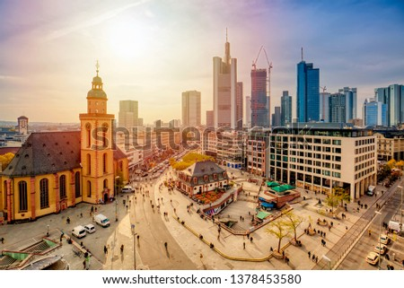 View to skyline of Frankfurt am Main during sunset. St. Catherine's Church and the Hauptwache Main Guard building with famous Frankfurt skyscrapers. Center of Frankfurt in Germany.