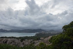 View to the bay of Cala Ratjada, Majorca, Spain. Stormy clouds and sea.