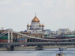 View to the Cathedral of Christ the Saviour passed bridge over the Moskva in Moscow, Russia