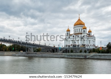 View to the Cathedral of Christ the Saviour under heavy clouds over river Moscow, Russian Federation