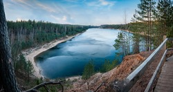 View to the Dubkalni Reservoir in Blue Hills of Ogre (Ogre Zilie Kalni). Nature Park with beautiful blue lake and pine forest. Latvia. Panorama.