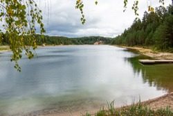 View to the Dubkalnu pit (quarry) and surrounding forest from the coast  on a cloudy day in September in Ogre in Latvia