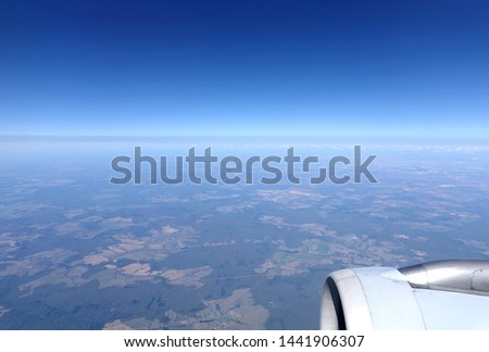 View to the earth from stratosphere from flying airplane #1441906307