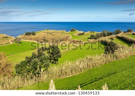 View to the green field, town and mountains at the Atlantic ocean coast, San Miguel, Azores, Portugal