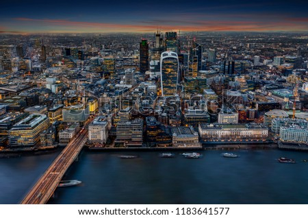 View to the illuminated City of London after sunset; the urban skyline of a modern metropolis, United Kingdom #1183641577