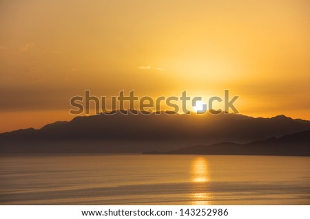 View to the Libyan Sea with the Lefka Ori Mountains or White Mountains on Crete at sunset