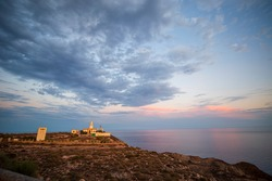 View to the Mesa Roldan Tower of 18th Century and the lighthouse, lies on a mountain Agua Amarga in the province of Almeria Cabo de Gata-Nijar Natural Park Andalusia Spain