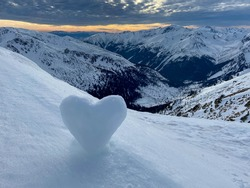 View to the mountains and heart shaped snowball on the ground, Poland
