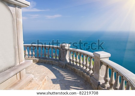 view to the sea from a balcony under blue sky