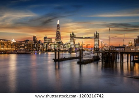View to the skyline of London during sunset time: The Tower Bridge and Tower area by the Thames river