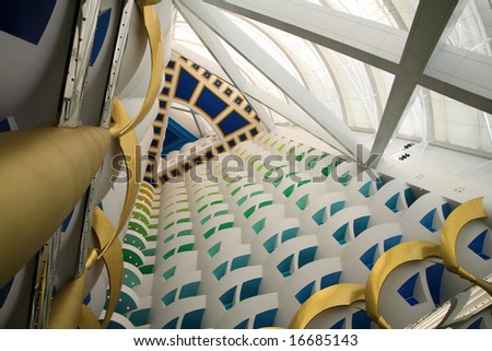 View to the top of the lobby in the Burj al Arab, the tallest hotel lobby in the world - stock photo