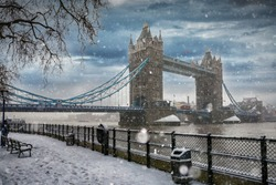 View to the Tower Bridge in London during winter time with a heavy snow storm