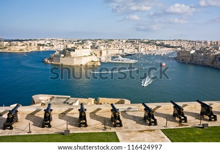 View to Vittoriosa Harbor and medieval cannons battery from Valetta wall, Malta