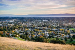 View towards Fremont and Union City from Garin Dry Creek Pioneer Regional Park on a sunny autumn evening, San Francisco bay, California