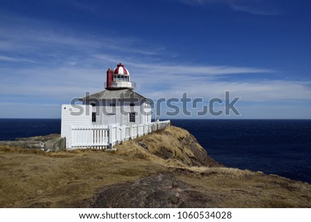 view towards the ocean at  with the  historic 19th century lighthouse keeper residence in the foreground at Cape Spear National Historic site, Avalon region Newfoundland Canada