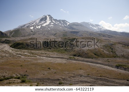 View towards the summit and crater of Mt. Saint Helens including the lava dome. After the 1980 eruption of this active volcano, there are still no trees although small plants are starting to grow.