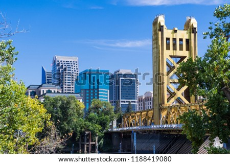 View towards the Tower Bridge and the skyscrapers in downtown Sacramento on a sunny day; California #1188419080