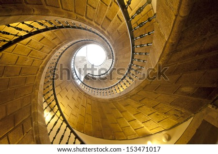 View up a dramatic double spiral staircase.
