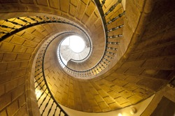 View up a dramatic triple spiral staircase.