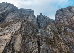 View up a giant rock face in Lysefjord, Norway, with the famous Preikestolen - or pulpit rock - in the middle