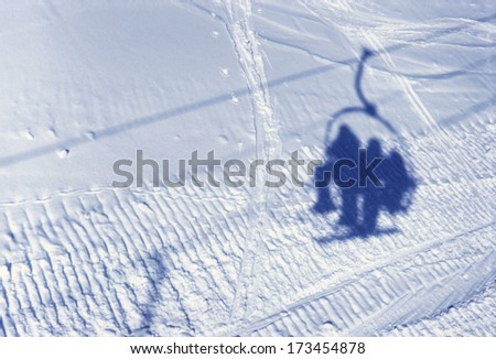 View upon Shadow of ski lift and people on snow in ski resort