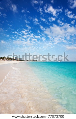 View west down the long white sand Grace Bay Beach, Turks & Caicos - stock photo