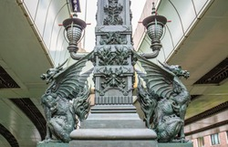 Viewed from a road, 19th century bronze dragon statues decorate the famous Nihonbashi (Japan Bridge) in Tokyo, Japan. It is the starting point to measure the distance of all roads to Tokyo.