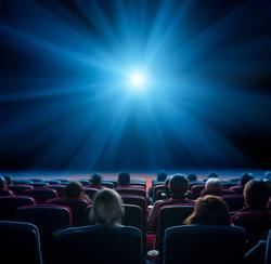 viewers watch blue star at cinema, long exposure, blue glow
