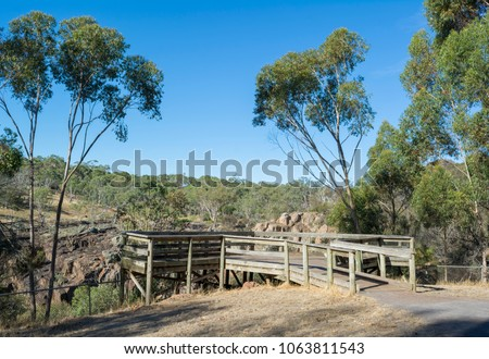 Viewing platform at Nigretta Falls during the dry season. Previously known as the Upper Wannon Falls in the Southern Grampians Shire, near Hamilton, Victoria and fed by Wannon River.  Stock photo ©