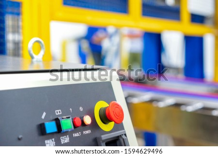 Viewof emergency switch robot controller in automation machine.