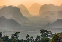 Viewpoint from the tiger temple ( Wat Tham Suea) on mountains at dusk in the Krabi province, Thailand