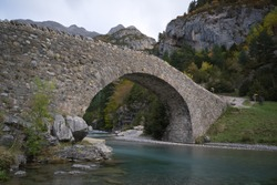 Views of Bujaruelo bridge in autumn. Autumn colors. Long exposure. Travel concept.Ordesa, Huesca, Spain