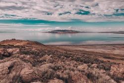 Views of Great Salt Lake at Antelope Island State Park, Utah, USA. Desert landscape, water reflections, dramatic clouds.