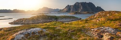 Views of Lofoten islands and around, in Norway, with blue sea and mountains during sunny arctic sunset.