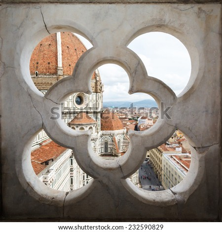views of the Cathedral Santa Maria del Fiore through the fence ornament bell tower in Florence, Italy