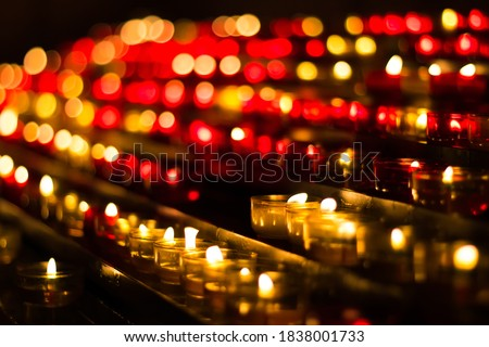 Photo of  Vigil Candles in French Monastery with Bokeh