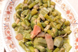 Vignarola is a typical dish of the Lazio region and typical food from Rome area based on Roman artichokes, peas, broad beans, asparagus and other fresh spring vegetables