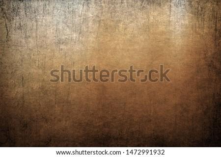 Vignette grunge scratched background, golden color texture