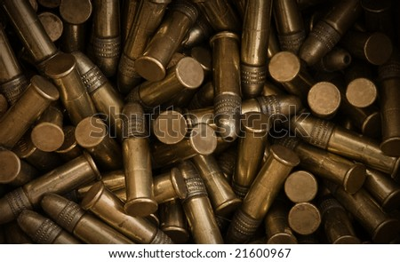 Vignetted close-up image of a box full of bullets