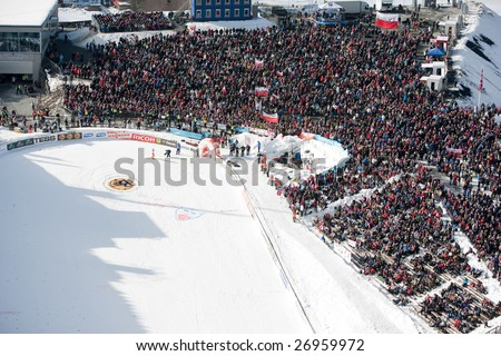 VIKERSUND, NORWAY - MARCH 15: Crowd cheering at the FIS World Cup Ski Jumping Competition.