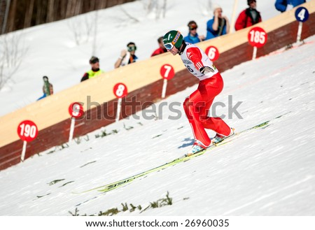 VIKERSUND, NORWAY - MARCH 15: Third place winner, Dimitry Vassiliev of Russia competes in the FIS World Cup Ski Jumping Competition on March 15, 2009 in Norway.