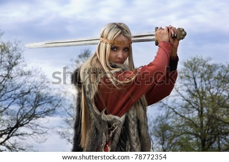 Viking girl warrior with sword fight