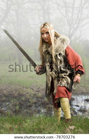 Viking girl warrior with sword in a fight